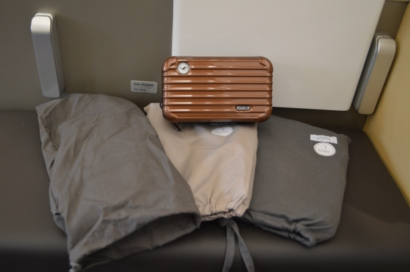 Comprehensive Rimowa amenity kit & pajamas